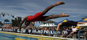 SANTA CLARA, CA - JUNE 20:  Simone Manuel dives in for the women's 100 meter freestyle final during the 2014 Arena Grand Prix of Santa Clara at the George F. Haines International Swim Center on June 20, 2014 in Santa Clara, California.  (Photo by Ezra Shaw/Getty Images)